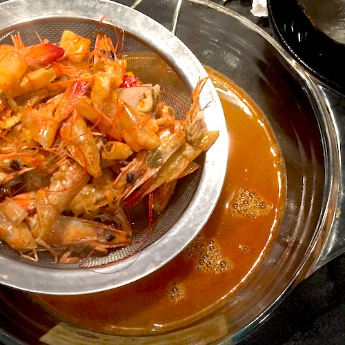 Your prawn stock should be a vibrant shade of orange.